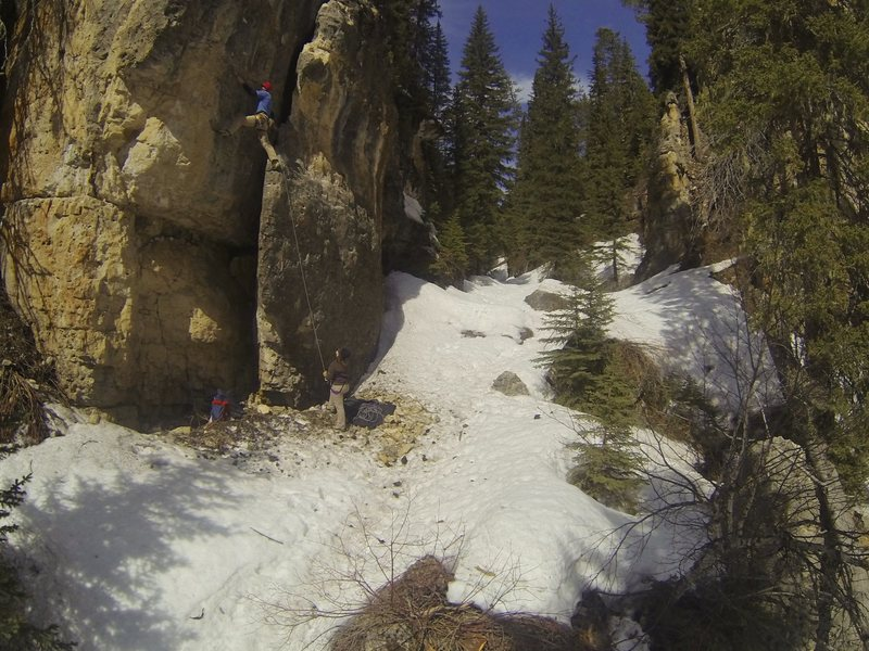 Making the transition from flake to face.<br> <br> Frosted Flake, 5.10c<br> Ice Box. Spearfish Canyon.<br> South Dakota.