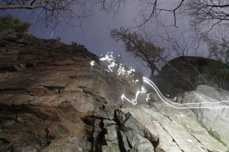 """Climbing """"The Entertainer"""" at Stewart's Ledge at night."""