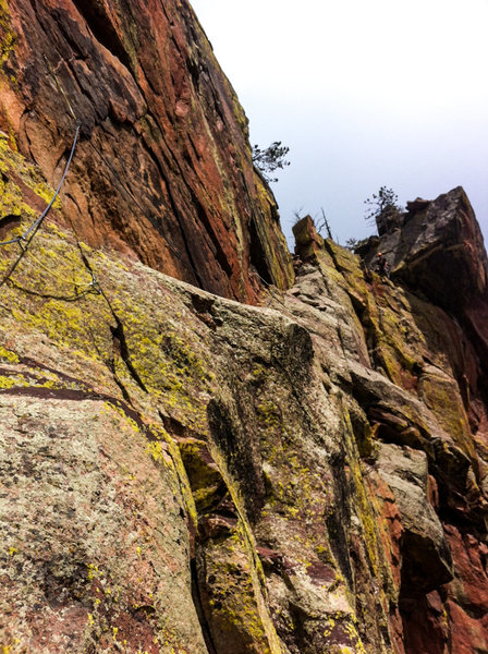 Three-Stage Traverse crosses the ledge before heading up to the top of the ridge.