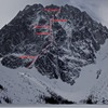 Dragontail Peak from the far end of Colchuck Lake.  Triple Couloirs marked.