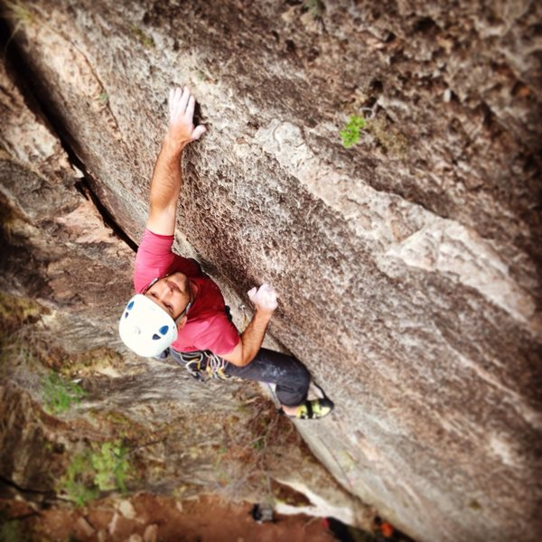 Reaching out of the crux.