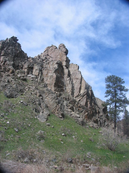A prominent fin of schist on the south side of the North Laramie River where the trail crosses the North Laramie River going upstream.