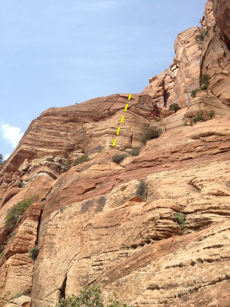 Route climbs up to and past the right leaning crack.