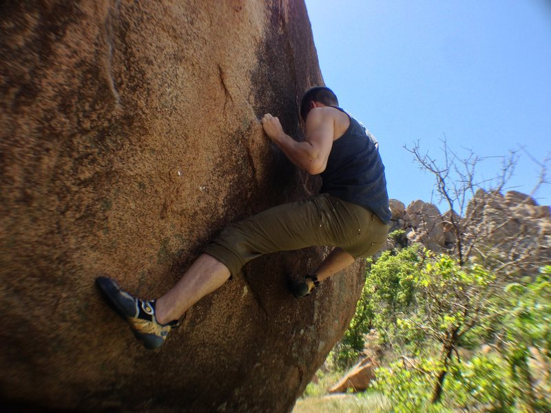 Rock Climbing Photo: Moving to the next crimp off the starting holds.