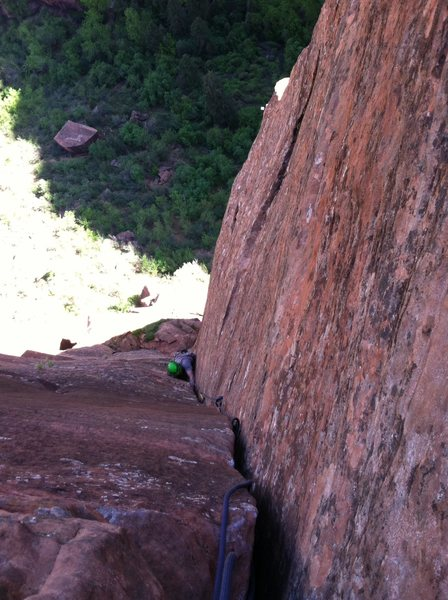 Looking down on the fist/wide hands section of pitch 3 from the midway natural belay stance.