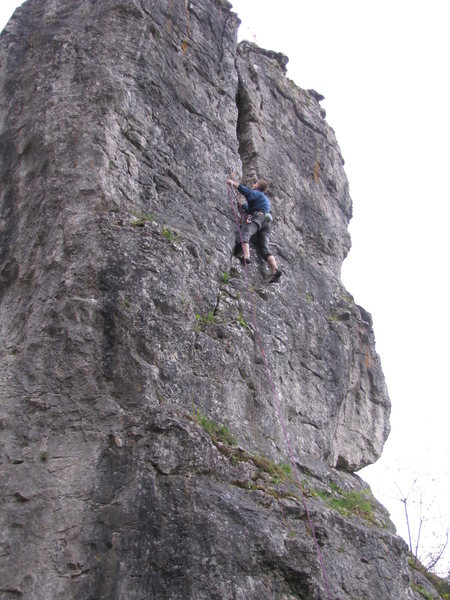 A climber clipping the 2nd bolt in Nordriss.