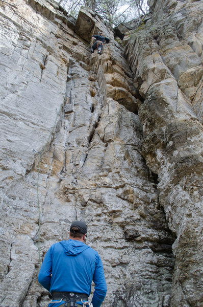Moving around the arete near the second to the last bolt.