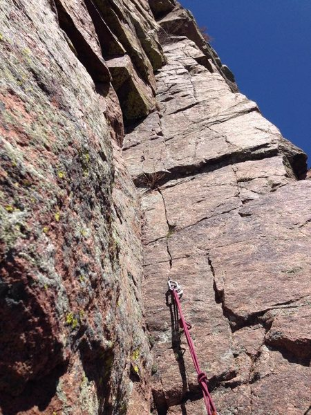 Belay ledge at the bottom of P3. A solid pin that can be backed up with small stoppers.