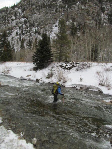 Fording the river with the route in the background.