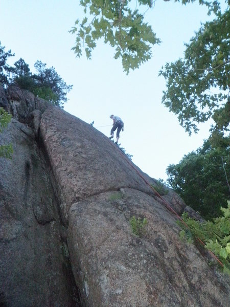 It's a poor photo, but it's all I've got. Unhappy Cracks is the flaring dihedral to the climber's left.