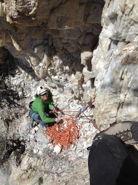 Looking down into the Quartz Cave, Amy at the belay.