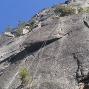 Climb the thin crack on the left to the roof, traverse right to the direct finish