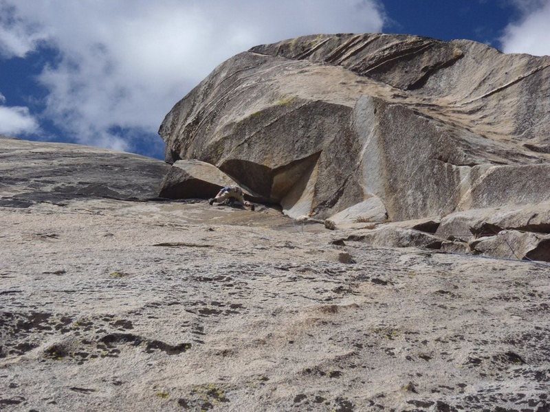 David B. post crux of the climb.  Headed left to the bolt anchor just to the side of the formation overhead.<br> <br> Pitch 4 goes up the dihedral.