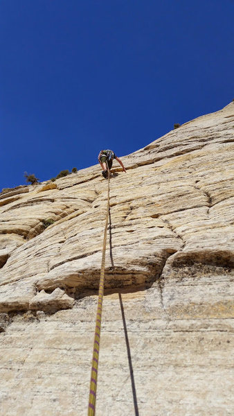 Rock Climbing Photo: John leading the rope up Aries Butte, Zion