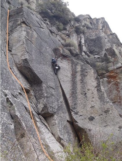 This climb is the left-facing corner left of Orange Wedge (which has a climber nearing the top)