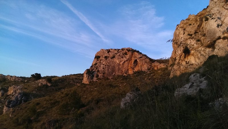 Sun setting on the Warm-up Wall viewed from the Upper Crag area