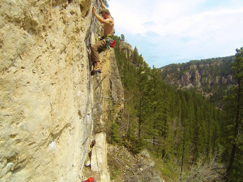Reggie screams out on Battlecry, 5.12c<br> Indian Wars Wall, The Mohican.<br> Spearfish Canyon.