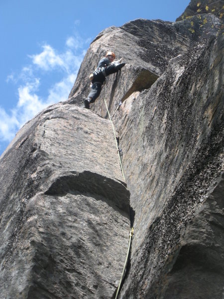 Matt stepping out of the crack and onto the arete