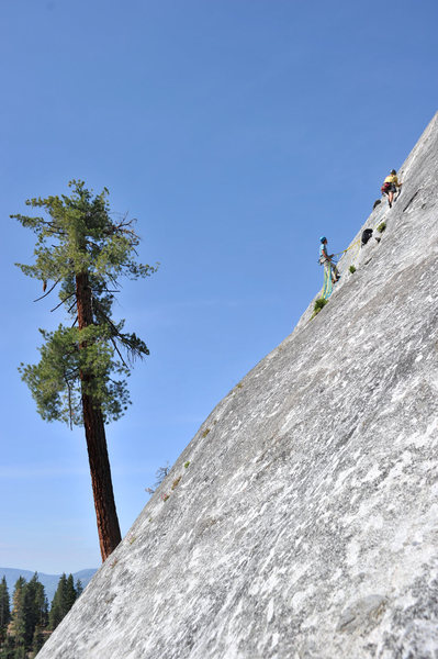 Casting off on the stellar second pitch of Tree Route, at Dome Rock