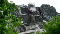 Rock Climbing Photo: Climber wrapping up at the top of Nutsweat, just p...