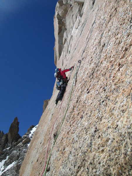 Rock Climbing Photo: Fiddling with small gear on pitch 2 crux