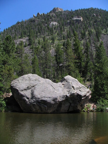 The Bog boulder in summer. Iron Helix starts in the dihedral on the right-hand side of the boulder and moves left.
