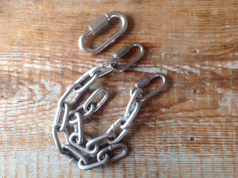 These chains had also been added.  Presumably they worked just fine for quite some time, but I wouldn't lock my bike up with these things. I added a quick link of what I'd consider to be a more commonly used size for scale.  Quick links and mussy hooks are now at the anchor.