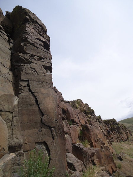 The route starts on the crack and climbs the arete