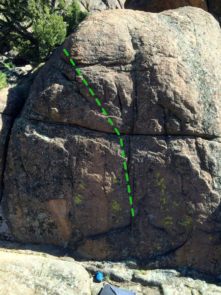 Move up the center crack to the horizontal, then move up and left over the corner of the boulder.