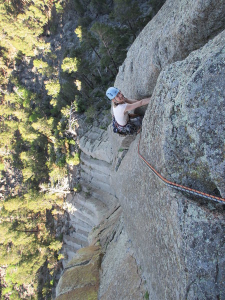 Kat A past the crux on Assembly Line (10a) and into the good handcrack above.