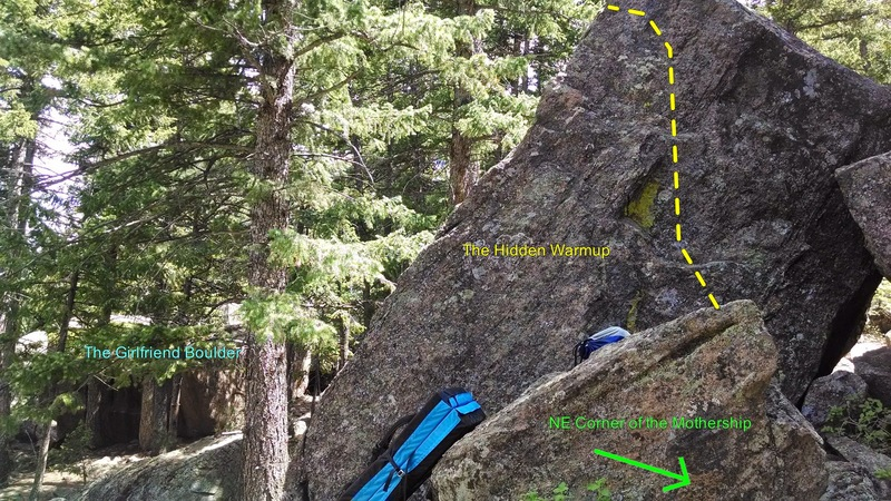 Hidden Warmup is close to the Girlfriend Boulder as shown in the photo. It's on the west side of the rock, so you have to walk around to see the route. The green in the middle of the rock gaurentees it's the right route. It's also immediately next to NE Corner of the Mothership.