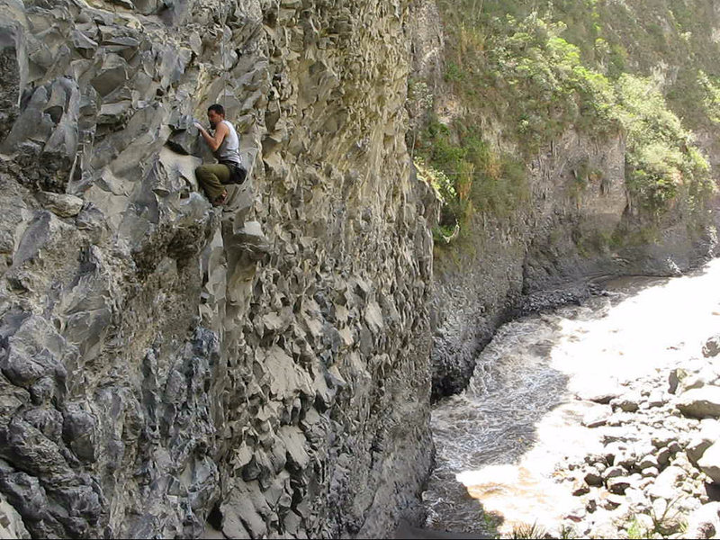 Mateo crimping with the mighty Pastaza River carving more volcanic basalt in this rock covered canyon.