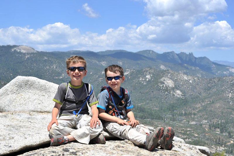 The boys scrambled 1,400 vertical feet up a steep ridge to nab the summit of Sentinel Peak, in the Southern Sierra. Dome Rock and the Needles are visible in the background.