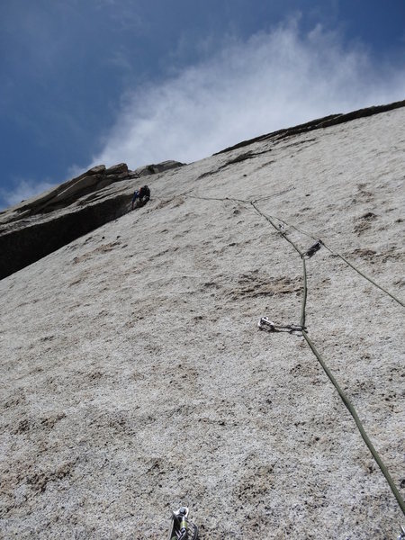 Looking up at the very blank crux pitch.