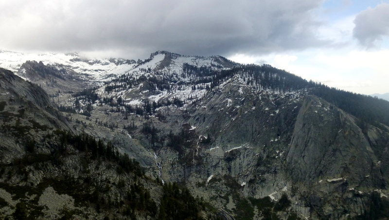 View of the Watchtower, Alta Peak and Tokopah Falls in the valley during an approaching storm.