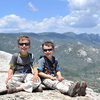 Bryson (7 years old) and Wesley (4 y.o.) pose atop Sentinel Peak, in the Upper Kern River Valley. Dome Rock and the Needles are visible in the background.