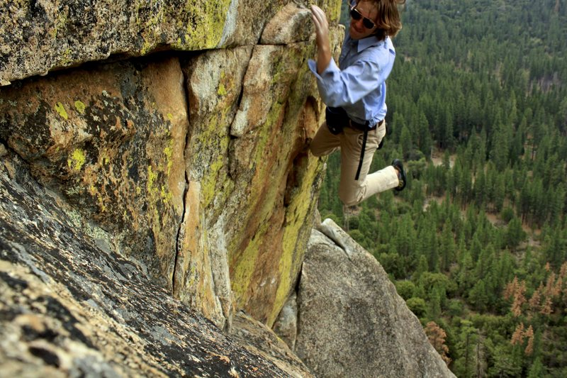 Pulling the roof variation of the last pitch.  Free solo in dress clothes for my last day in Yosemite!
