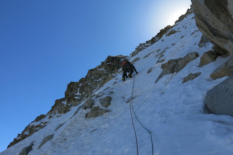 Exiting onto the upper face.
