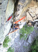Climb past two fixed pins and belay from nice stance just right of Broken Neck.