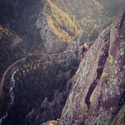 Rock Climbing Photo: Kasi Phanara cleaning up the exposed arete on the ...