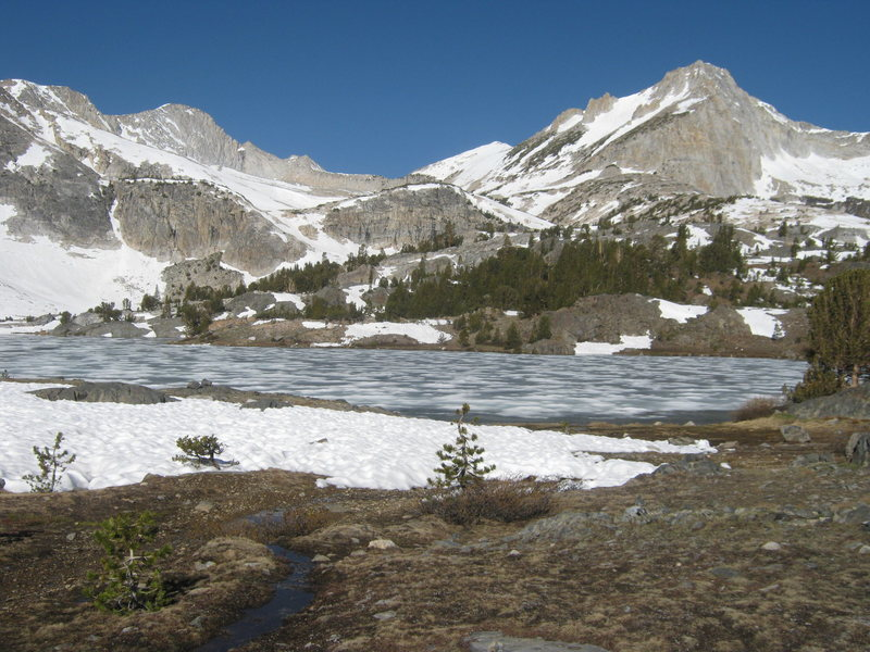 North Peak to right, over frozen-over Greenstone Lake. Mt. Conness to left.