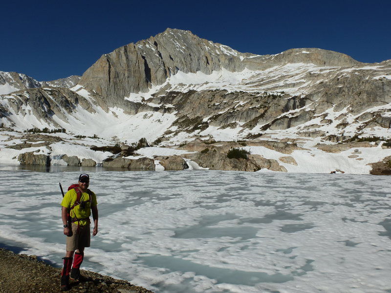 Barry near frozen-over Steelhead Lake, North Peak's North Face in view.  Northwest Ridge on right skyline.
