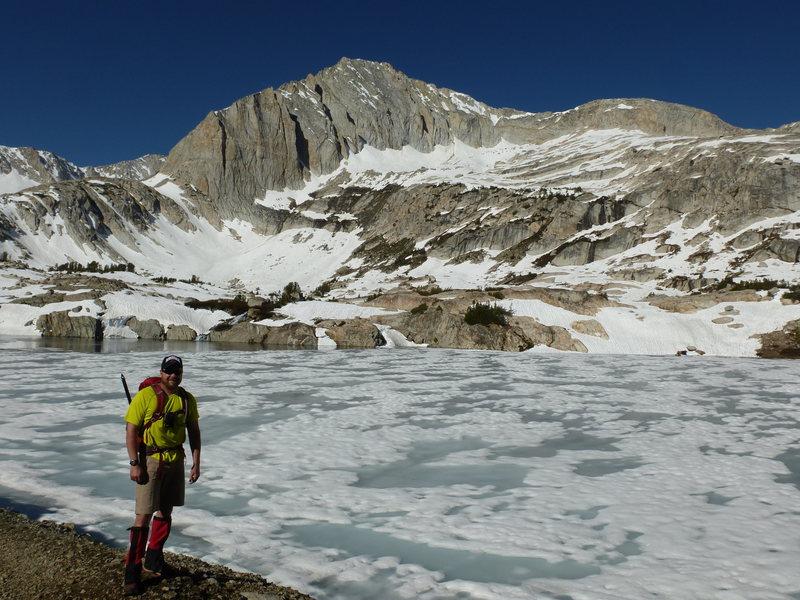 Barry near frozen-over Steelhead Lake, North Peak's North Face in view.  Northwest Ridge on right skyline.