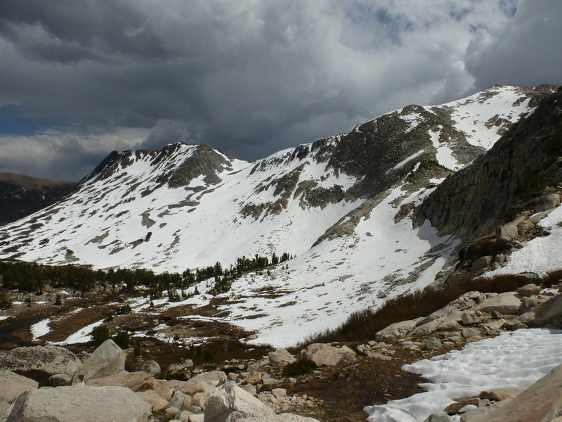 Still 2 hours from car, after summiting, clouds gathering rapidly.  Spinkles and a few lightning flashes an hour later.