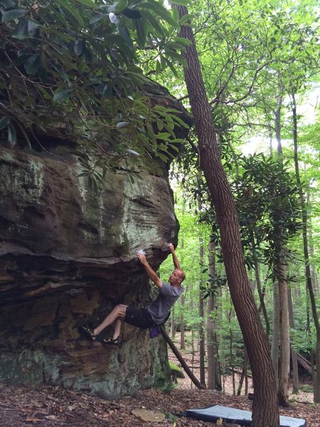 "Ray Weber at the ""Rainforest Cafe V2."" County Line boulders Coopers Rock WV."