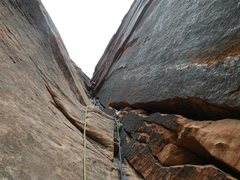 Rock Climbing Photo: Kevin runs up Iron Messiah p8 awesome black corner