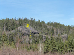 Rock facing Grand Lake rd near mount Shana (ski hill). 5 bolts located on peak of rock formation.