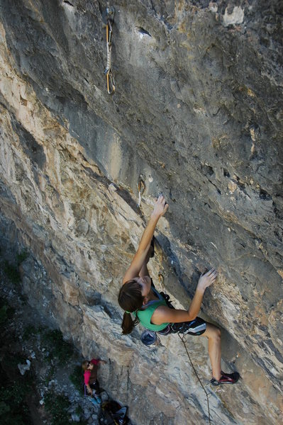 Page cranking through the steep start of a 5.12a near the left end of the cliff. The route is A View to a Kill.