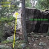 Alternate more direct, directions: once at the Girl Friend Boulder, go around it to its east side, and you should see two boulders with a pine in front of the second one. That second boulder is Two Aretes Are Better Than One, and the first has North Star.