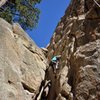 Marisa Fienup climbs through the crux of The Great Steps of Cheops, at Castle Rock.